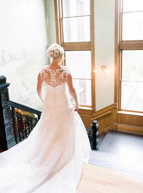 First look bride descending staircase Sioux Falls Old Courthouse Museum wedding photographer