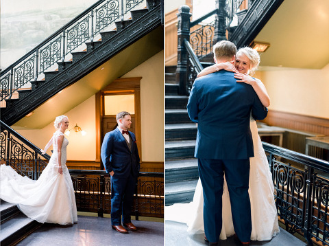 First look on grand staircase Old Courthouse Museum Sioux Falls wedding
